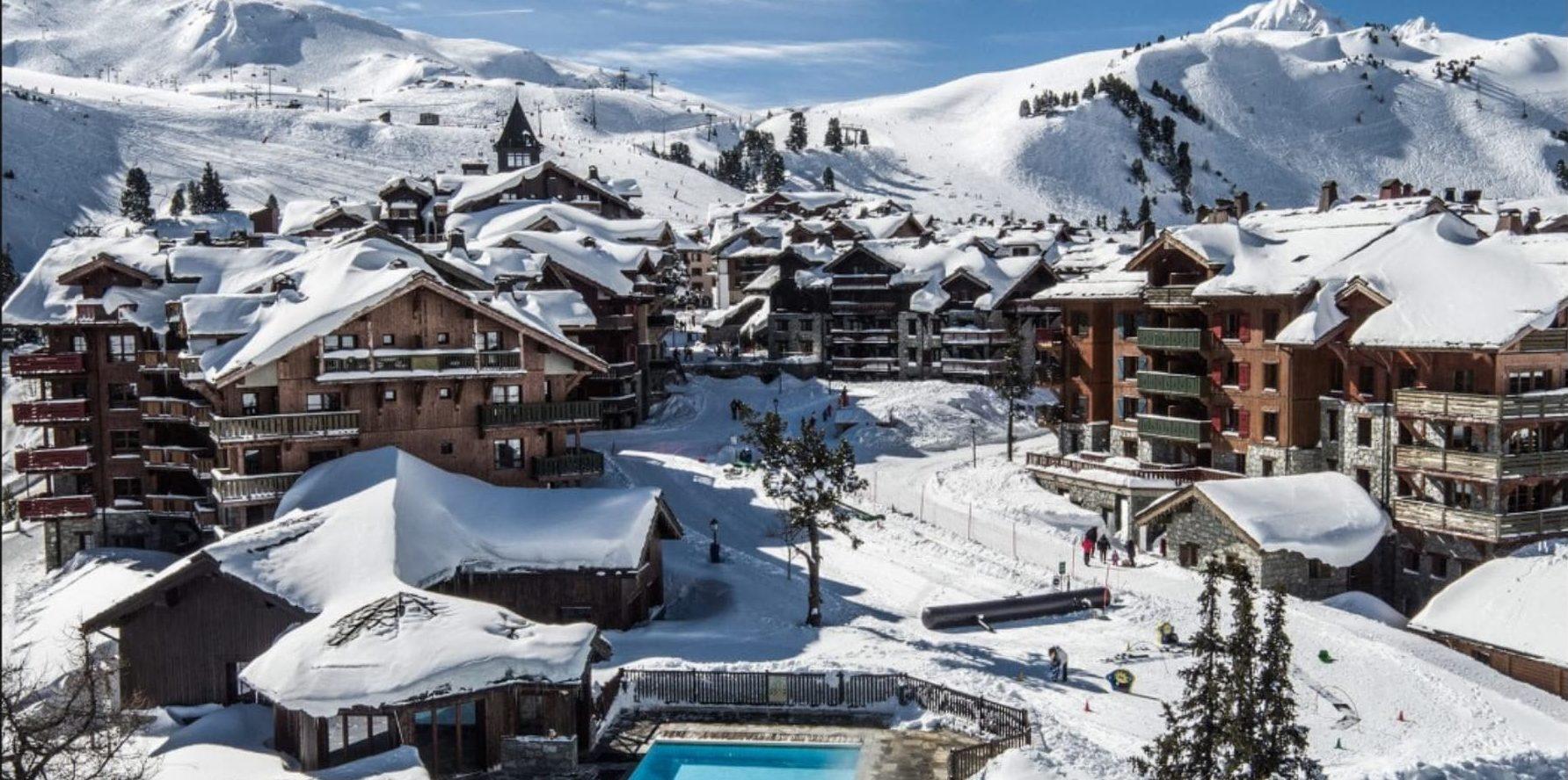 Les Arcs Paradiski Frankrijk wintersport skivakantie luxe dorpje appartementen bergen sneeuw bomen
