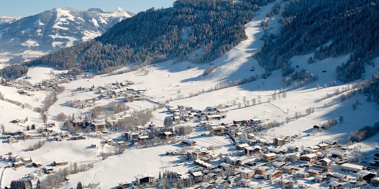 Niederau Wildschonau Oostenrijk wintersport skivakantie luxe familievriendelijk dorpje appartementen sneeuw bergen bomen