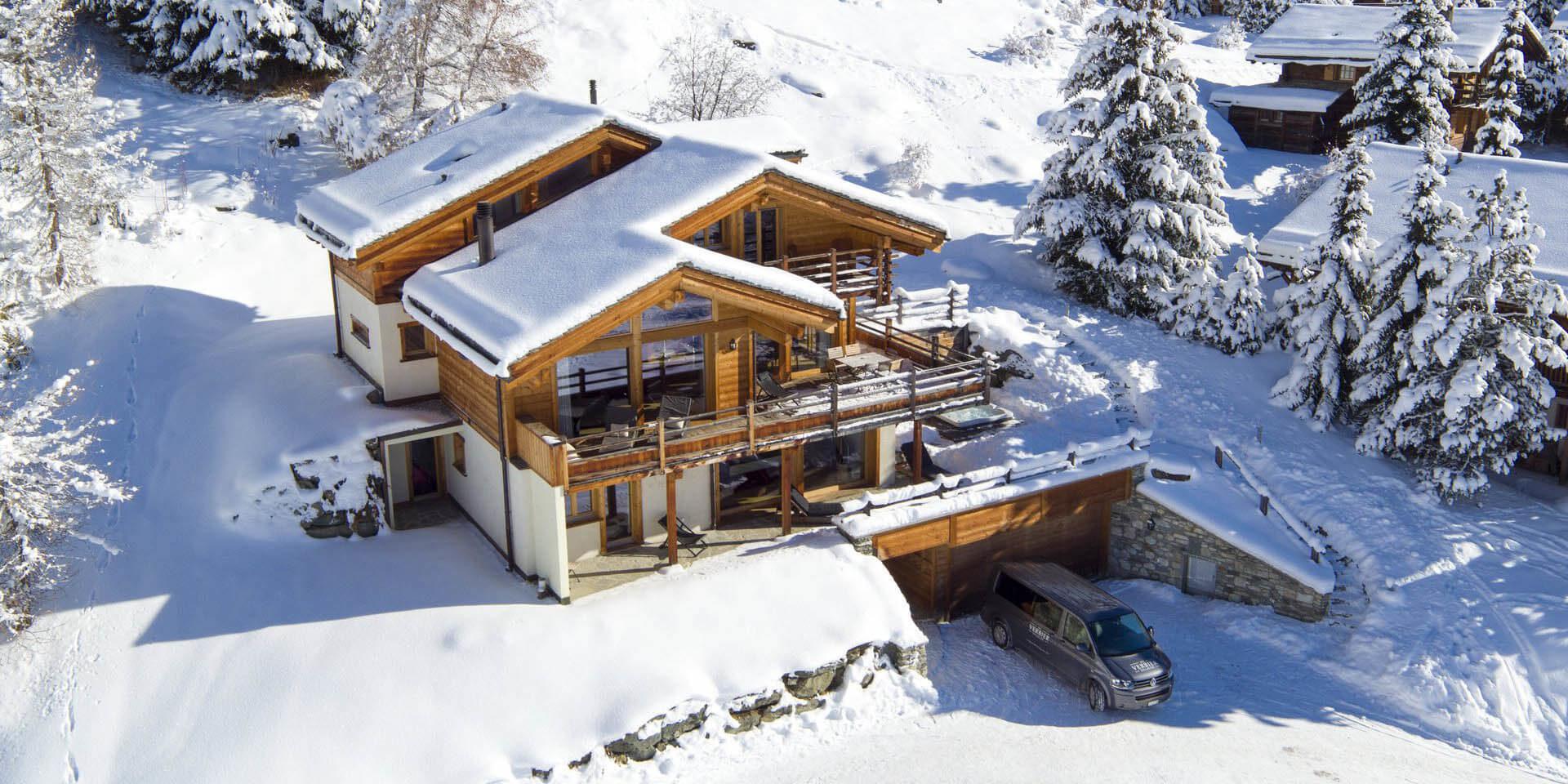 Chalet Rock Verbier Les 4 Vallees Zwitserland wintersport skivakantie luxe chalet garage balkons terras sneeuw besneeuwde bomen