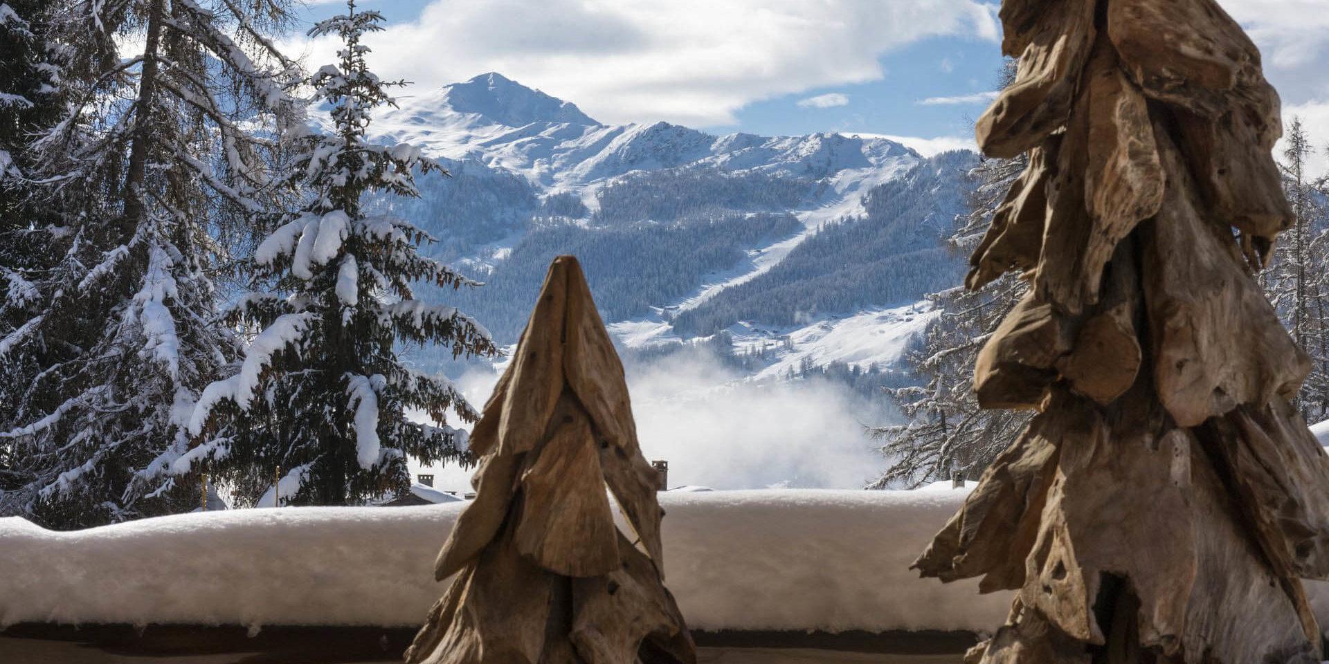 Appartement Rosalp 4 Verbier Les 4 Vallees Zwitserland wintersport skivakantie luxe uitzicht balkon besneeuwde bomen bergen sneeuw